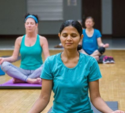 Three People in a Yoga Class